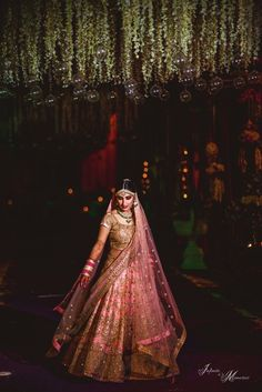 Twirling Bride - Bride in a Pink and Gold Wedding Lehenga   WedMeGood #weddinglehenga #wedmegood #lehenga #pink #gold #indianbride #indianwedding #twirling