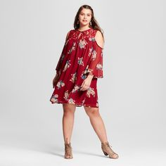 Keep your look bright and vibrant with this Floral Cold-Shoulder Dress from 3Hearts. Gold and teal flowers take bloom against the rust-colored background, giving this flowy dress eye-catching appeal. The open-shoulder design, lace accents and tie front give this piece all the detail you want. All you have to do is slip on some chunky heels, and you'll be ready to go.