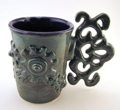 Steampunk mug, hardware, cup, coffee, tea, gears, clock works, metal. $32,00, via Etsy.