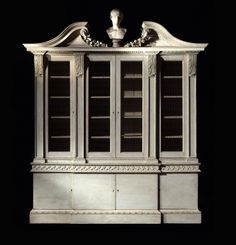 The Hackwood House Bookcase. An important George II period white painted architectural library breakfront bookcase. The design is attributed to John Vardy and the carving is attributed to Thomas Vardy. English, circa 1755 www.godsonandcoles.co.uk