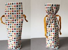 Wine bottle fabric bag with drawstring, free tutorial on Craftsy (Bottle Bag)
