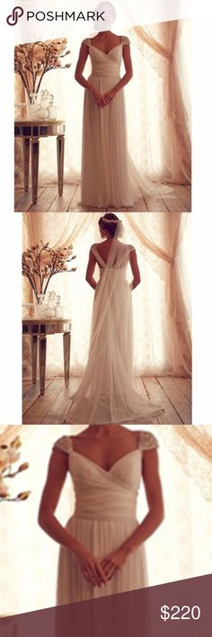 White Long Boho Wedding Gown Beautiful wedding gown. Long white wedding or prom gown. Brand new didn't wear to my wedding. Has silver sequin shoulder caps and beautiful open back about halfway. I paid alotttt for this handmade dress. No brand but is brand new! My loss, your gain. 👰🏻👸🏻 Dresses Wedding