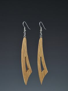 Mark Noll original design, Large Curve Pallet dangle earrings. These lightweight earrings are made from upcycled Pallet wood or other discarded wood. The wood is usually oak, but it might vary. The co