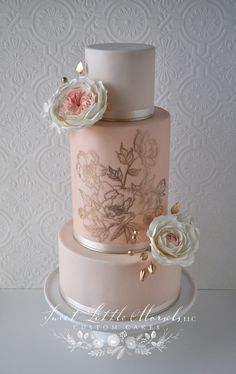 LOVE the soft colors and the double barrel painted middle tier. Would have to panel it with fondant.