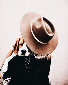 felt wide brimmed hats and a puppy dog... the best accessories around