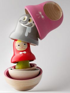 "Taiwan-based studio Pistacchi Design created this clever wooden matryoshka, titled ""Little Red,"" based on the classic fairy tale of Little Red Riding Hood. The crafted piece comes in three layers– Little Red Riding Hood sits inside the wolf, who is himself clad in the grandma's cloak."