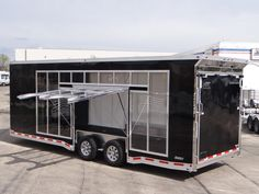 Custom 26' Glass Sided Enclosed Car Hauler. This Specially Made Car Hauler Features a 5,500 Pound Winch with a 60' Synthetic Rope, Several Interior 120 Volt Outlets, and a Custom Built Esacpe Door. Call for more information on this trailer. Ref # E203394 | Advantage Trailers and Hitches