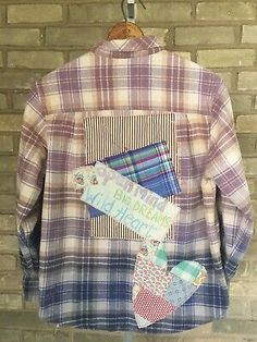 <p>One of a kind design~~gently worn flannel shirt was embellished using a patchwork of vintage fabrics. Lettering was created using fabric paint that is soft, permanent and machine washable!</p><p>This is a MEN'S size Medium so will fit up to a women's size Large with a boxy fit. </p><p>Please use the following measurements to determine fit:</p><p>Length 28</p><p>Pit to pit 21</p><p>Shoulder 15</p><p>Arm 22</p>