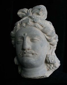 From the 200's-300's: a schist head of the Buddha - Gandhara.