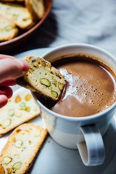 Crunchy orange pistachio biscotti with a rich and thick vanilla hot chocolate. Italian Cookie Recipes, Sicilian Recipes, Italian Cookies, Sicilian Food, Thin Biscotti, Biscotti Recipe, Yummy Drinks, Delicious Desserts, Dessert Recipes