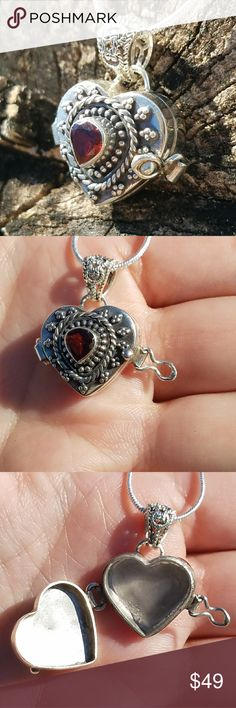 """Garnet Heart Poison / Locket 925 Necklace Sterling silver heart shaped poison pendant or locket necklace. Sterling silver 20"""" snake chain included. Opens with a clasp on the side as shown above. Reminds me of the Queen of Hearts. 7/8"""" length. Jewelry Necklaces"""