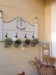 Reporpused headboard into a beautiful sign . I added some faux greenery.