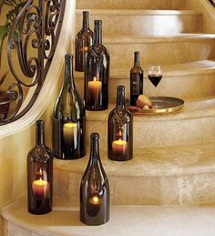 DIY Wine Bottle Centerpieces to hold a candle DIRECTIONS: labels removed, bottoms cut off, bumpers (like those you put on your cabinets to prevent banging when you close the door) to allow air flow so candles will stay lit, and candles placed inside.  Bottle tops will get VERY hot from candle heat.