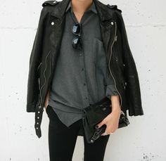A leather jacket paired with a grey flannel.
