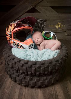 Motocross motorcycle newborn photography by Henry Roy Photography