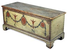 An Albany County, N.Y., pine blanket chest by an unknown maker exhibits Germanic construction traditions with a molded base and scrolled bracket feet. The decoration recalls the designs of Robert Adam. The chest was acquired through the Juli and David Grainger endowment.