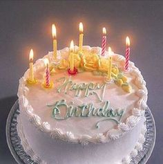 Cake on a pretty blue design plate, with eight lit candles and yellow roses. HAPPY BIRTHDAY FACEBOOK - https://www.pinterest.com/DianaDeeOsborne/happy-birthday-facebook/ - Collection for you to quickly find Just The Right Picture to send celebration greetings to that Special Person in your life.