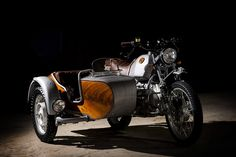 Wood, metal, and leather come together in harmony in the Ocgarage BMW R100 GS Avventura Motorcycle. The bike itself saw its engine rebuilt, with larger carbs and a new exhaust to help cope with the greater weight. The sidecar is...