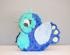 D.I.Y. PIÑATA!! Two lovebirds? A heart? These babies are made out of recycled corrugated cardboard boxes and cereal boxes, colored tissue paper, glue, masking tape and scissors.
