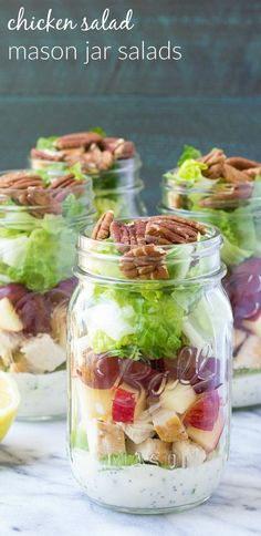 How to make an easy and healthy mason jar salad for make-ahead lunches! These Chicken Salad Mason Jar Salads with grapes, apple, and toasted pecans have a creamy, no mayo poppy seed dressing! | www.kristineskitchenblog.com