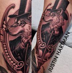 Realistic black & gray gentleman wolf by Justin Hartman at Urban Art Tattoo; Phoenix, AZ.