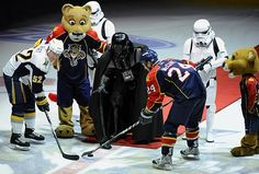 """Darth Vader and stormtroopers join the Panthers mascot Stanley C. Panther on the ice as Vader drops the puck for the Sabres' Craig Rivet and Panthers' Bryan McCabe on Oct. 21, 2009 in Sunrise, Florida."""