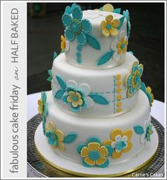 Teal and yellow fondant button cake