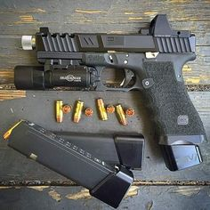 Glock 17 with a milled slide and RMR,  has a polished threaded barrel with RIP ammo and extended magazine 9mm