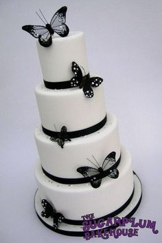 4 Tier Black White Butterfly Wedding Cake - Butterfly and diamond decorations are inedible.