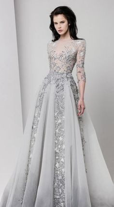 Glamorous unique silver beaded wedding dress with sheer quarter length sleeves; Featured Dress: Tony Ward (if this was a different color, I'd love it!...like lavender, Red, or black...)