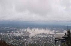 The moment the quake hit Christchurch.NZ.  - as captured by a tourist from the Port Hills