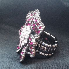 🌸Rhinestone & Pewter Flower Ring NWOT🌸 🚫PRICE CUT🚫 Flower Ring with Purple Rhinestone Petals surrounded by Pink Rhinestones in the Center. Set on an adjustable pewter ring. Never worn! Stunning!! Jewelry Rings