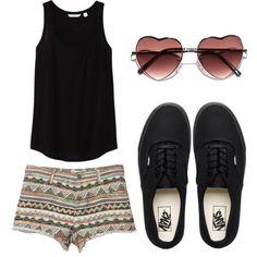 Heart-shaped glasses, black tank, tribal/aztec print shorts, black vans