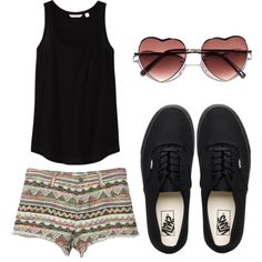 Heart-shaped glasses, black tank, tribal/aztec print shorts, black vans