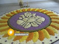 Rangoli is the best way to bring life to your homes during a festival. Here are some Ganesh rangoli designs for you to try in 2019 to enlighten your house Rangoli Designs Flower, Rangoli Designs Diwali, Rangoli Designs With Dots, Flower Rangoli, Beautiful Rangoli Designs, Onam Pookalam Design, Onam Wishes, Ganesha Rangoli, Happy Onam