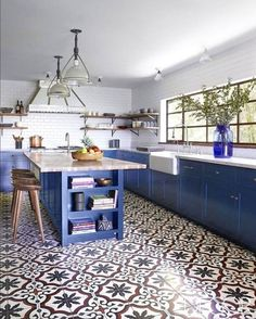 stunning blue cabinet island white marble countertop for mdoern kitchen design using country patterned tile floor