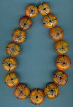 """Antique African """"Amber"""" beads that have been decorated with silver by Mauritanian silversmiths"""