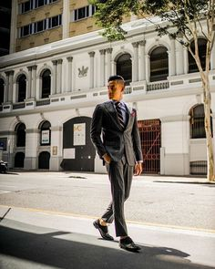 Stepping out from the shadows and taking on the day with a well fitted charcoal windowpane suit  @bows_n_ties accessories  // Men's Fashion Style and Travel Blog - http://ift.tt/29K1GdU