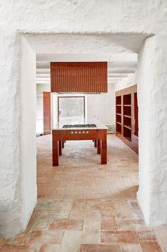 Arquitectura-G renovates Spanish farmhouse with glazed tiles Stone Archway, Terracotta Floor, Interior Architecture, Interior Design, Farmhouse Renovation, Glazed Tiles, Küchen Design, Design Ideas, House Design