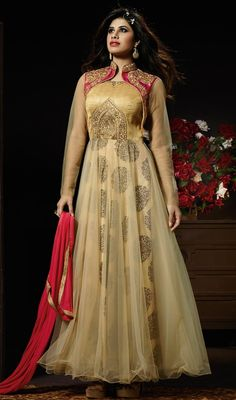 Pep up a pinch of aristocratic radiance with this cream and honey color georgette net long Anarkali suit. The brilliant attire creates a dramatic canvas with remarkable lace, resham and stones work. #awesomedesignanarkali #fabulousanarkalidresses #netanarkalisuit
