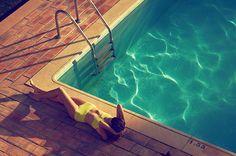 Swimming Pool Fashion: Model wearing yellow polka dot bikini