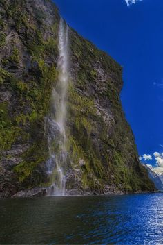 The mighty cliffs of Milford Sound, New Zealand | The Planet D Adventure Travel Blog: