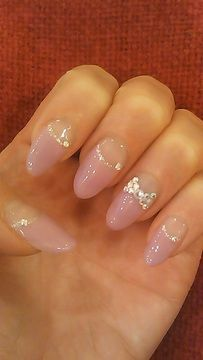 Pink ribbon. I don't care for stilleto nails but these are kinda cute!