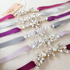 These dainty belts are the perfect finishing touch for the modern bride, or her bridesmaids. Each design is hand-soldered in my studio by me and each is uniquely different. Customize however you'd like. **To view more of my work, and see more custom designs, please visit my Instagram (helenanoellecouture).** -Available in any color combination -Beading …