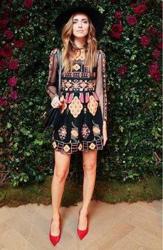 Chiara Ferragni in wide-brim hat and boho-print mini dress