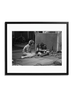 """Mick Jagger & Keith Richards Rolling Stones Photograph    Photographed by LarryEllis on June 12, 1968 @ the Olympic Sound Studios while making Jean Luc Godard's semi documentary movie 'Sympathy for the Devil'  Hand printed on Fuji Crystal Archive paper    Numbered and certified on the reverse and limited to 495 examples worldwide  Approximate measurements: length: 20"""", width: 24"""".  Brand: Sonic Editions    Material: Fuji Crystal Archive Paper, Wood    $249 on @Gilt"""
