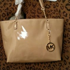 Michael Kors EW Chain tote in nude color Nude Patent leather Michael Kors tote beautiful chain detail on straps, one outside pocket and multiple inside compartments. MICHAEL Michael Kors Bags Totes