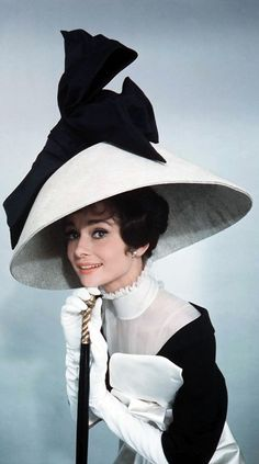 "Audrey Hepburn models the costumes of ""My Fair Lady"" for both photographer costume designer for the film Cecil Beaton.:"
