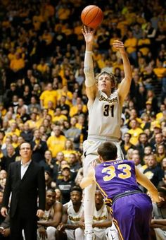 Wichita State guard Ron Baker shoots over Northern Iowa guard Wyatt Lohaus during the second half at Koch Arena on Saturday.