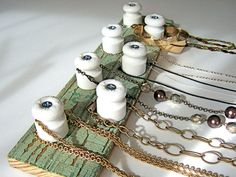 Jewelry organizer or medals display. Electric fence porcelain insulators and green crackle vintage patina painted wood.. $28.00, via Etsy.